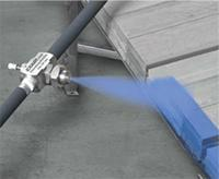 A Model AN1010SS Narrow Angle Atomizing Nozzle is used to mark strips of steel before they leave the mill.
