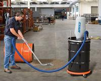 The Heavy Duty Dry Vac cleans up a spill of steel shot.