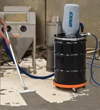 Sand that covers the floor around a sand blaster is quickly vacuumed into the drum using the rugged floor tool.